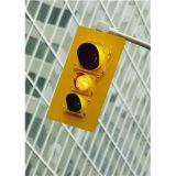 What should you do at a yellow light?